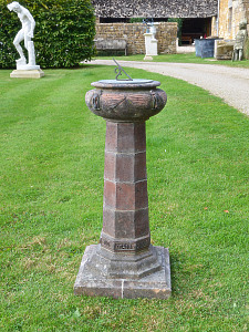 An Arts & Crafts terracotta sundial attributed to the Compton Pottery