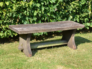 A rustic oak plank bench