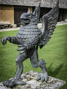A mighty lost-wax cast bronze Griffin sculpture by John Ravera PPRBS / FRSA (1941-2006)