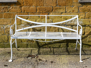 A 19th century wrought iron garden bench