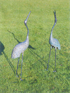 A pair of Japanese Taisho Period bronze cranes