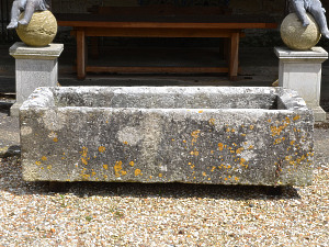 A large 18th century rectangular stone trough