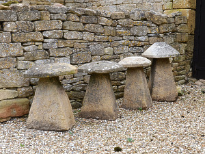 A group of four Cotswold stone staddle stones