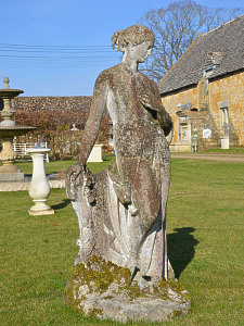 A 19th Century composition stone garden figure of Flora by Austin and Seeley