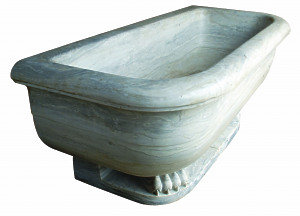 A massive marble Spa Bath raised upon lion paw feet