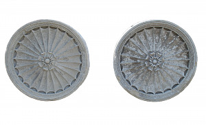 A pair of 18th century Portland Stone roundels