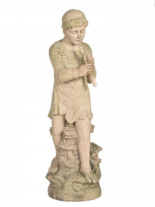 A rare Terracotta statuette of a young boy playing a pipe