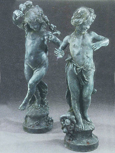A pair of rare lead statues by the Bromsgrove Guild