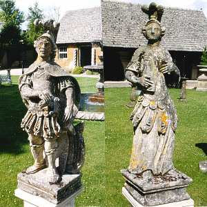 A pair of 18th Century French stone statues depicting male and female Roman warriors