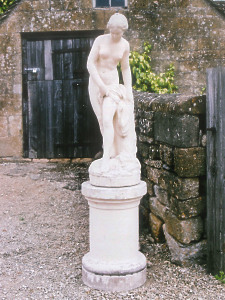 A mid 19th Century French composition statue of Venus at Bath (currently painted) raised on a circular pedestal