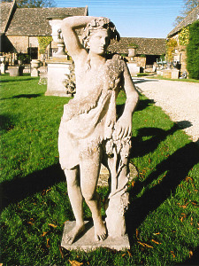 A 19th Century, circa 1880, composition stone statue of Bacchus by Austin & Seeley
