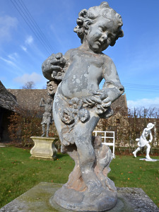 A lead figure depicting Summer as a cherub