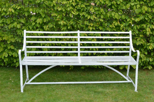 A wrought iron garden bench