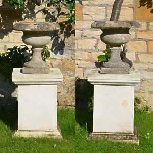 A pair of 19th century Bath stone tazza shaped urns