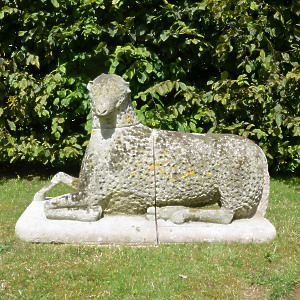 A large carved natural Bath stone Folk Art sheep