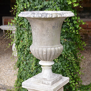An Italian weathered white marble campana urn