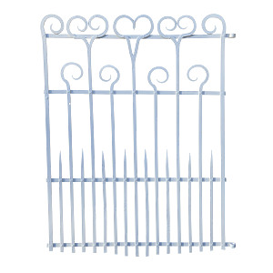 A small wrought iron garden gate having crook and heart motif decoration