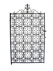 A decorative mid 20th century wrought iron garden gate