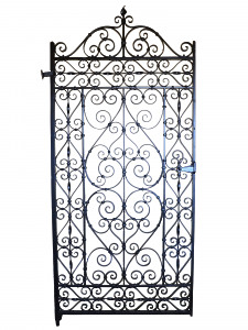 A decorative wrought iron garden gate
