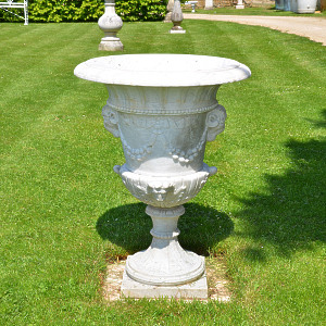 A Carved White Marble Campana Shaped Urn