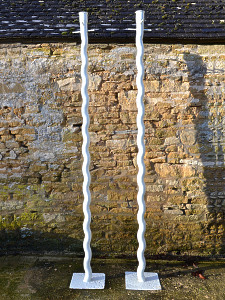 A unique pair of iron washing line poles of sugar twist design