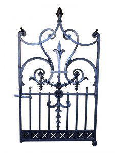 A fine cast iron garden gate having decorative scroll work foliate gadroons topped out with an acorn motif