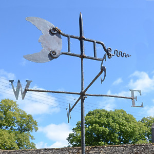 A 'Folk Art' weather vane having a copper Man in the Moon sail