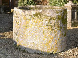 A large antique circular limestone trough