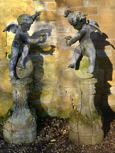 A pair of early 20th century winged lead putti