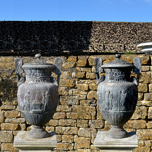An early 20th century pair of covered lead vases based on the 'Sosibios Vase' in the Louvre