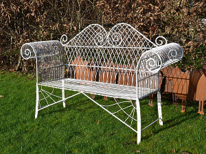 A decorative mid 20th century wirework garden bench