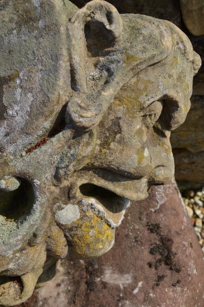 A 19th century carved sand stone keystone