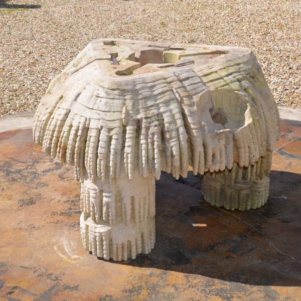A Coade stone triangular fountain base by Coade