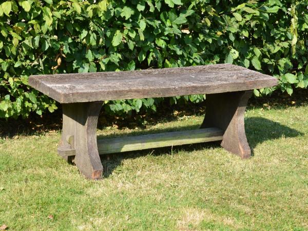 A rustic oak plank bench
