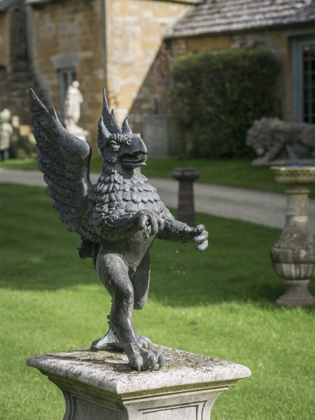 A mighty lost-wax cast bronze Griffin sculpture by John Ravera PPRBS / FRSA (1941-2006)