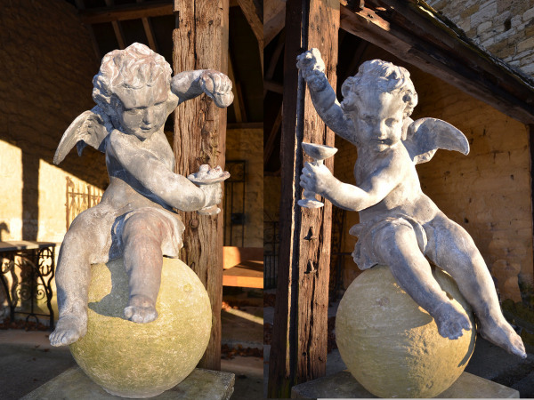 A pair of early 20th century lead Putti
