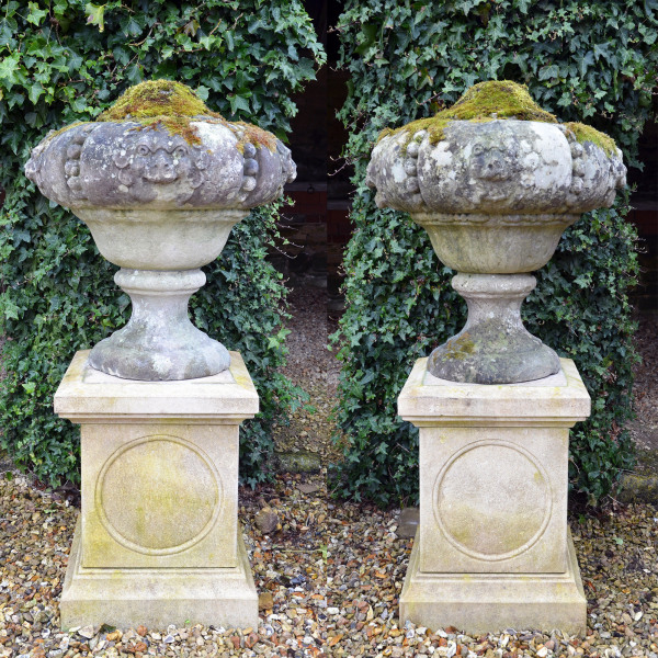 A large pair of late 19th / early 20th century Portland stone finials