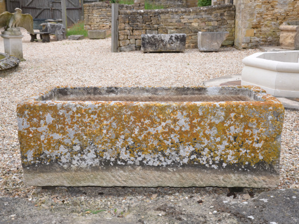 A large and beautifully patinated rectangular stone trough