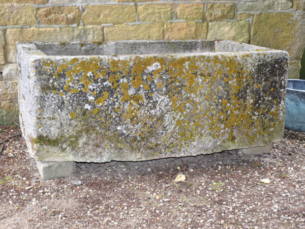 A large rectangular stone trough