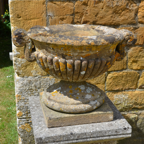 A 19th century single Ham stone urn