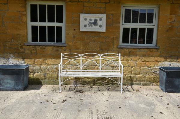 A wrought iron Regency garden seat