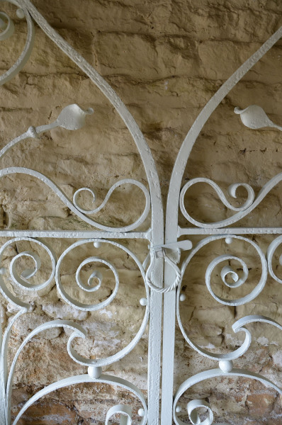 A pair of extraordinary early 20th century wrought iron garden gates