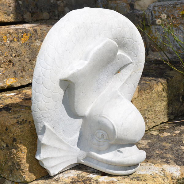 A marble fountain spout in the form of a stylised dolphin