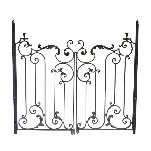 A pair of early 20th century forged iron and brass gates