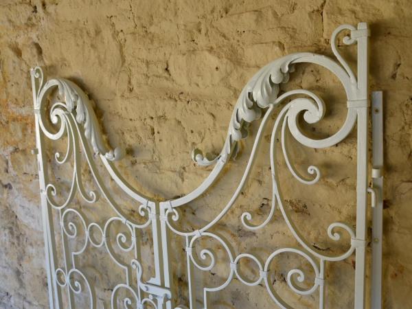 A pair of wrought iron garden gates in the Rococo taste
