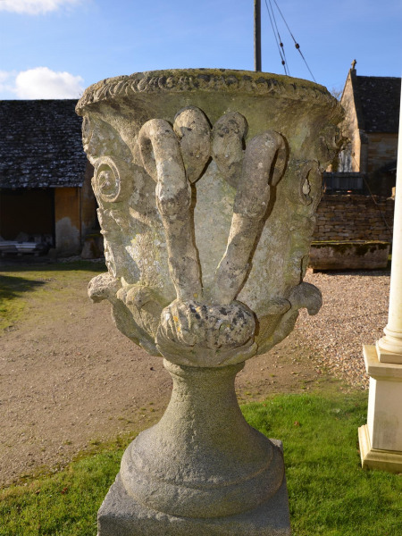 A pair of large carved Bath stone finial urns (solid)