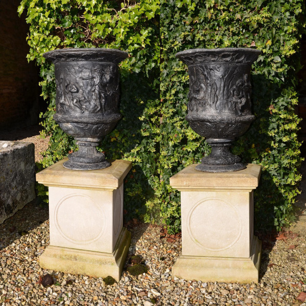 A pair of early 20th century lead urns of Campana form