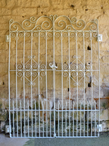 A pair of decorative wrought iron garden gates