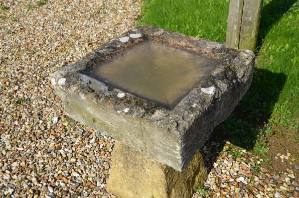 A Cotswold stone birdbath