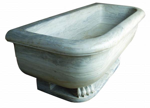 A massive marble Spa Bath raised upon lion paw feet